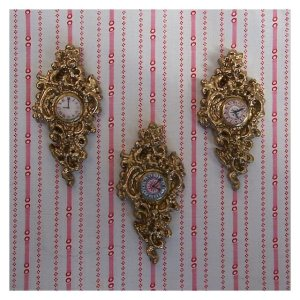 open_house_miniatures_three_cinderella_cartel_clocks_striped_fabric