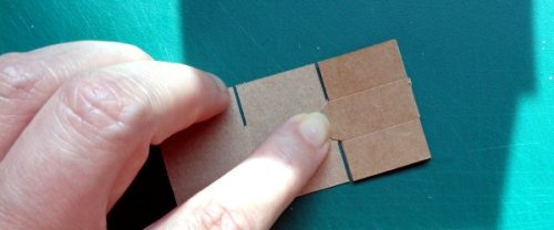 making a miniature cardboard box - fold the side flap in first